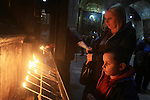 Palestinian Christians and pilgrims light candles at the Church of the Holy Sepulchre Celebration the coming of Christmas in Jerusalem's old city on Dec. 08, 2015. The Church of the Holy Sepulchre is one of the most Holy sites in the Christian world and its site in Jerusalem is identified as the place both of the crucifixion and the tomb of Jesus of Nazareth. The church has long been a major pilgrimage center for Christians all around the world. Photo by Mahfouz Abu Turk