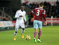 Pictured L-R: Modou Barrow of Swansea against Aaron Cresswell of West Ham Saturday 10 January 2015<br />