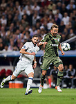 Jakub rzezniczak of Legia Warszawa battles for the ball with Karim Benzema (l) of Real Madrid during the 2016-17 UEFA Champions League match between Real Madrid and Legia Warszawa at the Santiago Bernabeu Stadium on 18 October 2016 in Madrid, Spain. Photo by Diego Gonzalez Souto / Power Sport Images