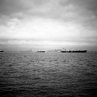 Ships wait in New York Bay just off Staten Island to enter the docks at Bayonne, New Jersey. Manhattan, Jersey City and Brooklyn can be seen behind. The docks of New York and New Jersey have for generations been synonymous with organised crime, with the Genovese family in control of the New Jersey waterfront and the Gambinos in control of the New York side.
