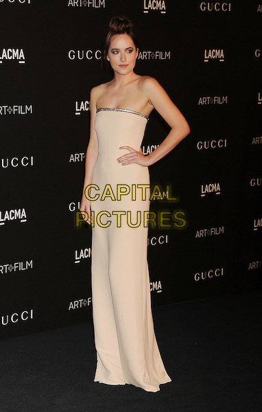 LOS ANGELES, CA - NOVEMBER 01: Actress Dakota Johnson attends the 2014 LACMA Art + Film Gala honoring Barbara Kruger and Quentin Tarantino presented by Gucci at LACMA on November 1, 2014 in Los Angeles, California.<br /> CAP/ROT/TM<br /> &copy;Tony Michaels/Roth Stock/Capital Pictures