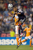 Houston Dynamo midfielder Brian Mullan (9) and New England Revolution defender Darrius Barnes (25) battle for head ball. The New England Revolution defeated Houston Dynamo, 1-0, at Gillette Stadium on August 14, 2010.