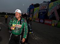 Aug 17, 2014; Brainerd, MN, USA; NHRA funny car driver John Force during the Lucas Oil Nationals at Brainerd International Raceway. Mandatory Credit: Mark J. Rebilas-