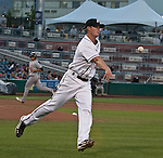 Reno Aces pitcher Charles Brewer flips the ball to first for the out against the Sacramento River Cats during their game on Monday night July 30, 2012 at Aces Ballpark in Reno, Nevada.