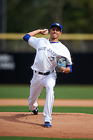 Dunedin Blue Jays pitcher Conner Greene (13) delivers a warmup pitch during the first game of a doubleheader against the Palm Beach Cardinals on July 31, 2015 at Florida Auto Exchange Stadium in Dunedin, Florida.  Dunedin defeated Palm Beach 7-0.  (Mike Janes/Four Seam Images)