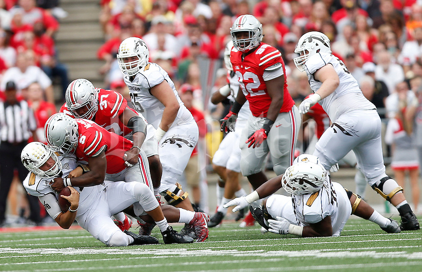 Ohio State Buckeyes linebacker Raekwon McMillan (5) sacks Western Michigan Broncos quarterback Zach Terrell (11) in the second quarter of the college football game between the Ohio State Buckeyes and the Western Michigan Broncos at Ohio Stadium in Columbus, Saturday afternoon, September 26, 2015. The Ohio State Buckeyes defeated the Western Michigan Broncos 38 - 12. (The Columbus Dispatch / Eamon Queeney)