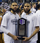 Nevada's Cody Martin and twin brother Caleb Martin hold the Mountain West Championship trophy after their team's win over San Diego State in an NCAA college basketball game in Reno, Nev., Saturday, March 9, 2019. (AP Photo/Tom R. Smedes)