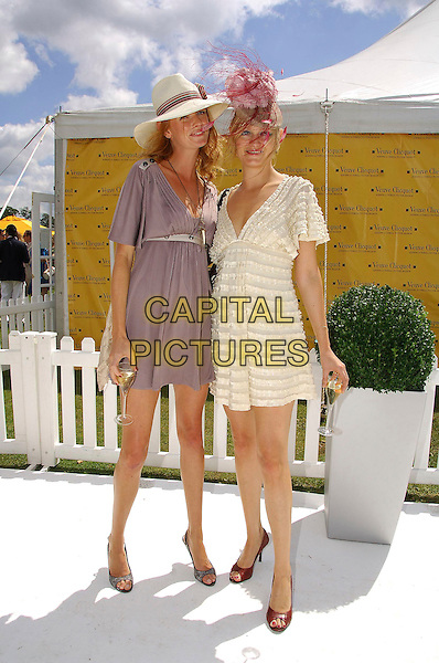 OLIVIA INGE & ALEXIA INGE.at the Veuve Clicquot Gold Cup Polo, .at the Cawdrey Park Polo Ground in East Sussex,.England, 22 July 2007..full length pink feather hat hats grey cream ruffle dress.CAP/CAS.©Bob Cass/Capital Pictures.
