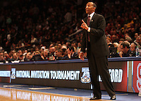 Stanford's head coach Johnny Dawkins yells to his team during the second half against UMass in a semifinal game of the NIT at Madison Square Garden, New York, N.Y., Tuesday, March 27, 2012. Stanford defeated UMass 74-64.