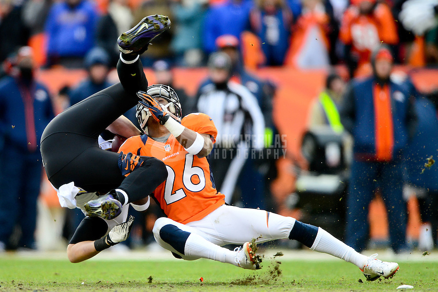 Jan 12, 2013; Denver, CO, USA; Denver Broncos safety Rahim Moore (26) tackles Baltimore Ravens tight end Dennis Pitta in the first half during the AFC divisional round playoff game at Sports Authority Field.  Mandatory Credit: Mark J. Rebilas-