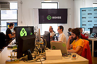 Employees at Boxee's Headquarters in the Chelsea neighborhood in New York, on Monday, October 1, 2012.  Boxee sells a software and hardware product that enables streaming of video from the internet onto your television. (© Frances M. Roberts)