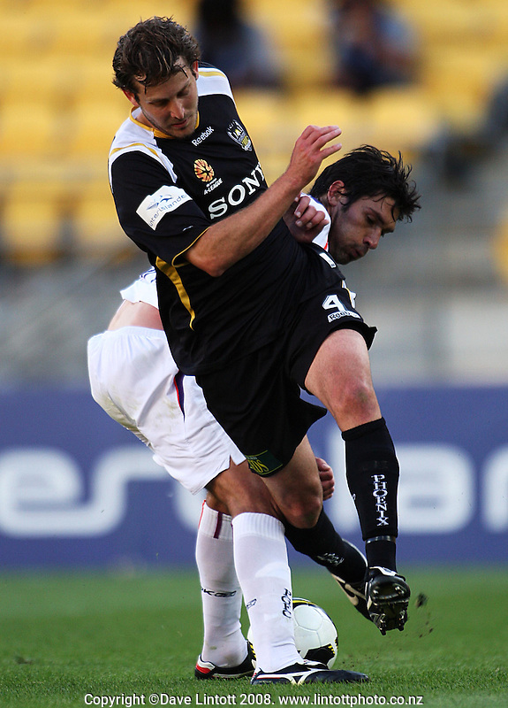 Glory's Nikolai Topor-Stanley tackles Jon McKain during the A-League football match between the Wellington Phoenix and Perth Glory at Westpac Stadium, Wellington, New Zealand on Saturday, 13 December 2008. Photo: Dave Lintott / lintottphoto.co.nz