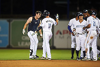 West Michigan Whitecaps first baseman Will Allen (left) celebrates with Will Maddox (11) after a game winning base hit during a game against the Burlington Bees on July 25, 2016 at Fifth Third Ballpark in Grand Rapids, Michigan.  West Michigan defeated Burlington 4-3.  (Mike Janes/Four Seam Images)
