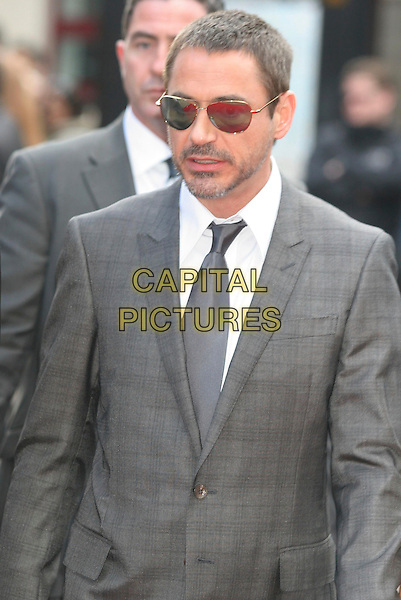 "ROBERT DOWNEY JR. .Attending the ""Iron Man"" UK Film Premiere at the Odeon, Leicester Square, London, England, .24th April 2008..half length beard stubble smiling sunglasses grey gray tie suit.CAP/DS.©Dudley Smith/Capital Pictures"