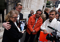 Funerali dell'attrice svedese Anita Ekberg, alla chiesa evangelica luterana a Roma, 14 gennaio 2015.<br /> Christina Ekberg, left, and Thomas Gundersen hold a picture of their parent, Swedish actress Anita Ekberg, at the end of the funeral service celebrated at the Christuskirche Lutheran Evangelical church in Rome, 14 January 2015.<br /> UPDATE IMAGES PRESS/Riccardo De Luca