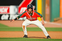 Cameron Flynn (11) of the Greensboro Grasshoppers takes his lead off of first base against the Delmarva Shorebirds at NewBridge Bank Park on May 26, 2013 in Greensboro, North Carolina.  The Grasshoppers defeated the Shorebirds 11-2.  (Brian Westerholt/Four Seam Images)