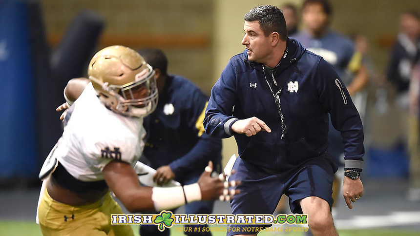 Defensive line coach Mike Elston