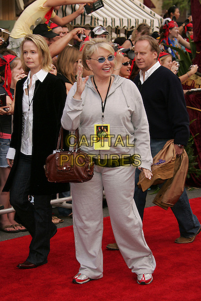 "ROSANNE BARR.The ""Pirates of the Caribbean 2: Dead Man's Chest"" World Premiere - Red Carpet, Anaheim, California, USA,.24th June 2006..full length grey tracksuit sweats hand waving.Ref: ADM/RE.www.capitalpictures.com.sales@capitalpictures.com.©Russ Elliot/AdMedia/Capital Pictures."
