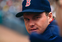 OAKLAND, CA - Roger Clemens of the Boston Red Sox watches from the dugout area during a game against the Oakland Athletics at the Oakland Coliseum in Oakland, California in 1987. Photo by Brad Mangin