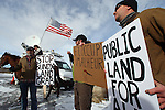 Biologists Kieran Suckling, (left to right) Cody Martz, and Taylor McKinnon hold protest signs at the Malheur National Wildlife Reserve on January 16, 2016 in Burns, Oregon.  They were protesting the protesters took over the refuge on Jan. 2 after a rally to support the imprisoned local ranchers Dwight Hammond Jr., and his son, Steven Hammond. ©2016. Jim Bryant Photo. All Rights Reserved.