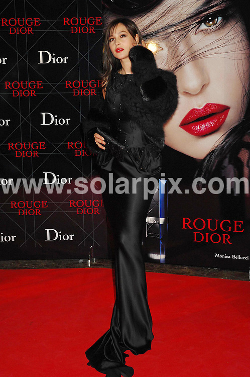 **ALL ROUND PICTURES FROM SOLARPIX.COM**.The Christian Dior dinner presentation unveiling Monica Bullucci as the Dior advertising campaign last night at The stock Market Palace in Madrid Spain..This Pic.Actress Monica Bellucci.DATE: 15/11/2006-JOB REF: 3062-SPA