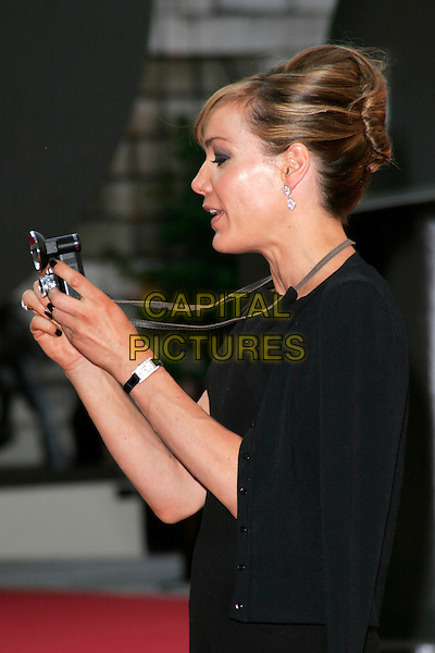TARA PALMER TOMKINSON.The Royal Academy of Arts Summer Exhibition 2008 preview party at Royal Academy of Arts in London, England..June 4th, 2008.half length black dress camera TPT watch profile nail varnish polish .CAP/AH.©Adam Houghton/Capital Pictures.