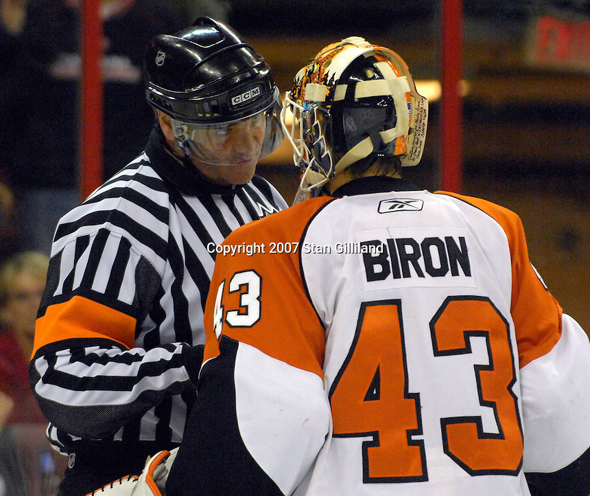 The Philadelphia Flyers' goalie Martin Biron speaks with an official during their game with the Carolina Hurricanes Wednesday, Nov. 21, 2007 in Raleigh, NC. The Flyers won 6-3.