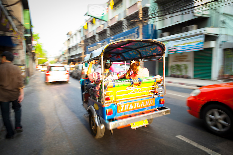 The auto rickshaw, called tuk-tuk in Thailand, is a widely used form of urban transport in Bangkok and other Thai cities, as well as other major Southeast Asian and South Asian cities. It is particularly popular where traffic congestion is a major problem, such as in Bangkok. The name is onomatopoeic, mimicking the sound of a small (often two-cycle) engine. There are no meters, and trip costs are negotiated in advance. Bangkok fares have risen to nearly equal normal taxis due to foreigners willing to pay the asking price, but leaves passengers more exposed to environmental pollution than taxis. The solid roof is so low that the tuk-tuk is a difficult touring vehicle. Today few locals take one unless they are burdened with packages.