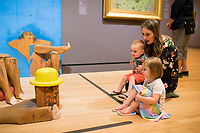 NWA Democrat-Gazette/CHARLIE KAIJO Amanda Hubbard of Fayetteville (from right) looks at an art piece with D.C. Hubbard, 2 and Diana May Hubbard, 3, in the Early American Art Gallery, Friday, March 23, 2018 at Crystal Bridges Museum of Modern American Art in Bentonville. <br /><br />The museum offered free artmarking, acitivities and performances for Spring Break.