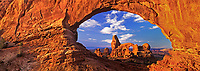 902100003 panoramic image of turret arch framed through north window arch an iconic scene in arches national park in utah