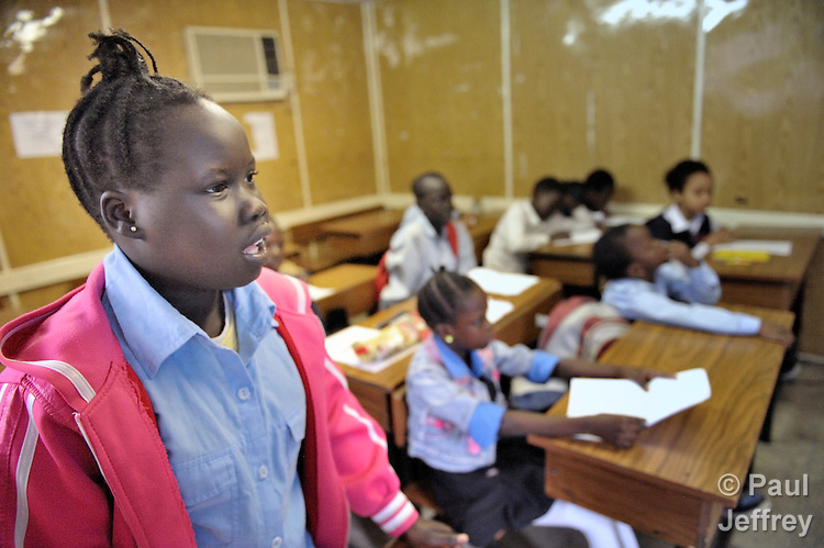 A refugee girl in class in a school operated by St. Andrew's Refugee Services in Cairo, Egypt. Located at St. Andrews United Church of Cairo, the program is supported by Church World Service.