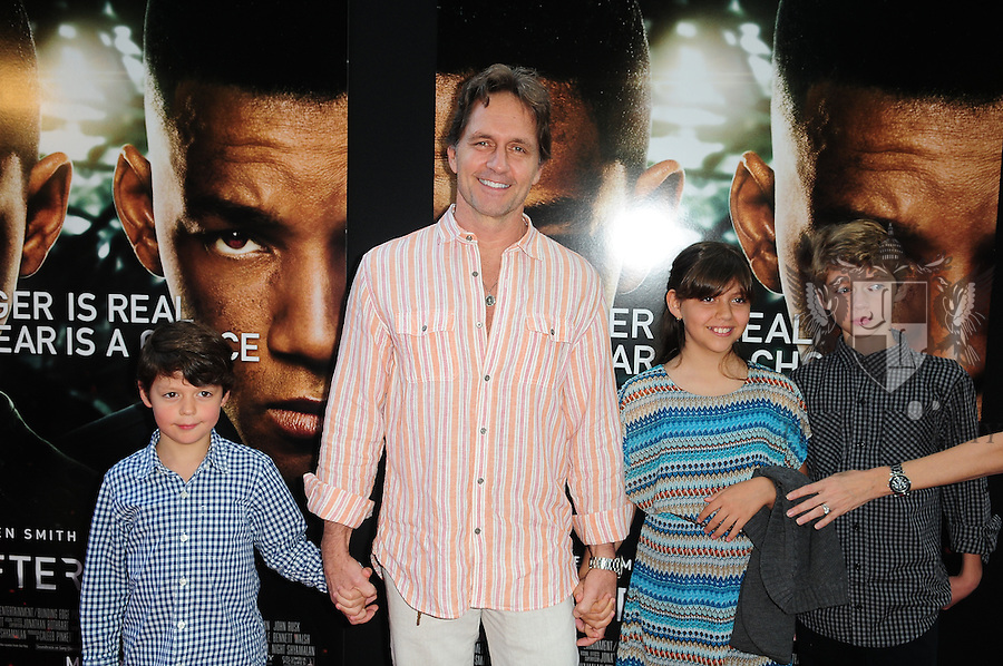 MIAMI, FL - MAY 16: Guy Ecker (2nd from L) with his kids Liam, Sofia and Kaelam attend the AFTER EARTH Day with Will Smith and son Jaden Smith at Miami Science Museum and Planetarium on May 16, 2013 in Miami, Florida. (Photo by Johnny Louis/jlnphotography.com)