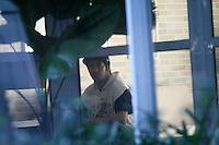 SÃO PAULO - SP - 06 DE MARÇO 2013. MORTE CHORÃO, nChampignon, baixista da banda de rock santista, Charlie Brown Jr, é visto no saguão do prédio de Chorão, vocalista e líder da banda, onde o músico foi encontrado morto nesta madrugada, 6, em Pinheiros, na zona oeste de São Paulo. FOTO: MAURICIO CAMARGO / BRAZIL PHOTO PRESS.