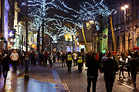 Revellers in Wind Street, Swansea, Wales  on Mad Friday, Booze Black Friday or Black Eye Friday, the last Friday night before Christmas Day, when traditionally people in the UK go out to celebrate the start of their holidays. Friday 22 December 2017