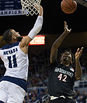 San Diego State guard Jeremy Hemsley's (42) shot is blocked by Nevada forward Cody Martin (11) in the second half of an NCAA college basketball game in Reno, Nev., Saturday, March 9, 2019. (AP Photo/Tom R. Smedes)