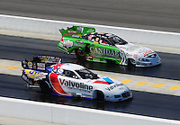 Sept. 19, 2010; Concord, NC, USA; NHRA funny car driver Jack Beckman (near) races alongside Paul Lee during the O'Reilly Auto Parts NHRA Nationals at zMax Dragway. Mandatory Credit: Mark J. Rebilas-