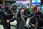 KRASNAYA POLYANA, RUSSIA  - JANUARY 17:<br /> USA bobsled Head Coach Brian Shimer, left, congratulates pilot Steven Holcomb, with helmet, as Nick Cunningham, back center, Cory Butner, back right, and Dallas Robinson, front right, celebrate with brakeman Steven Langton, back right, after competing in the men's two-man bobsled at Sanki Sliding Center during the 2014 Sochi Olympics Monday February 17, 2014. USA-1 with Steven Holcomb, of Park City, Utah, and Steve Langton, of Melrose, Mass., won the bronze medal with a time of 3:46.27.<br /> (Photo by Chris Detrick/The Salt Lake Tribune)
