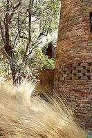 Rustic style round stone accommodation, part of the Singita Pamushana Lodge, Malilongwe Trust, Zimbabwe.