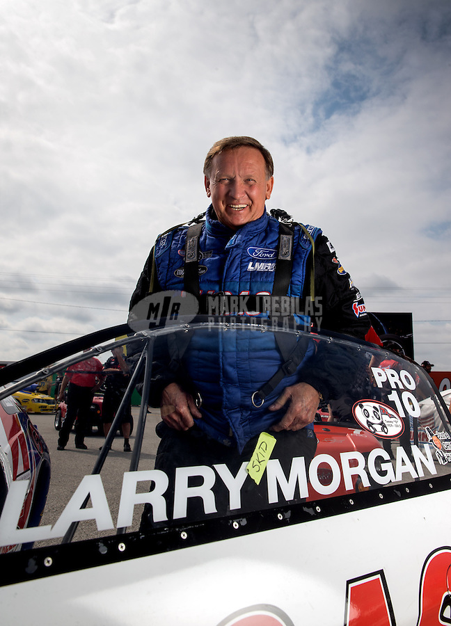 Sept. 1, 2013; Clermont, IN, USA: NHRA pro stock driver Larry Morgan during qualifying for the US Nationals at Lucas Oil Raceway. Mandatory Credit: Mark J. Rebilas-