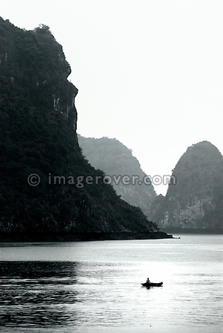 Asia, Vietnam, Halong Bay. Boat on the Halong Bay. Designated a UNESCO World Heritage Site in 1994, the sensational Halong Bay is spread across 1.500 sq km, with more than 2.000 pinnacle shaped limestone and dolomite outcrops scattered across it. The impression is a labyrinthine seascape of bizarrly shaped outcrops, isolated caves, and sandy coves.