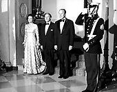 United States President Gerald R. Ford, right, Chancellor Helmut Schmidt of Germany, center, and first lady Betty Ford, right,pose for a formal photo prior to a State Dinner in the Chancellor's honor at the White House in Washington, DC on December 5, 1974.  Schmidt is scheduled to speak with the President about the oil problem and the economy.  Helmut Schmidt passed away on November 10, 2015 at age 96.<br /> Credit: Barry Soorenko / CNP
