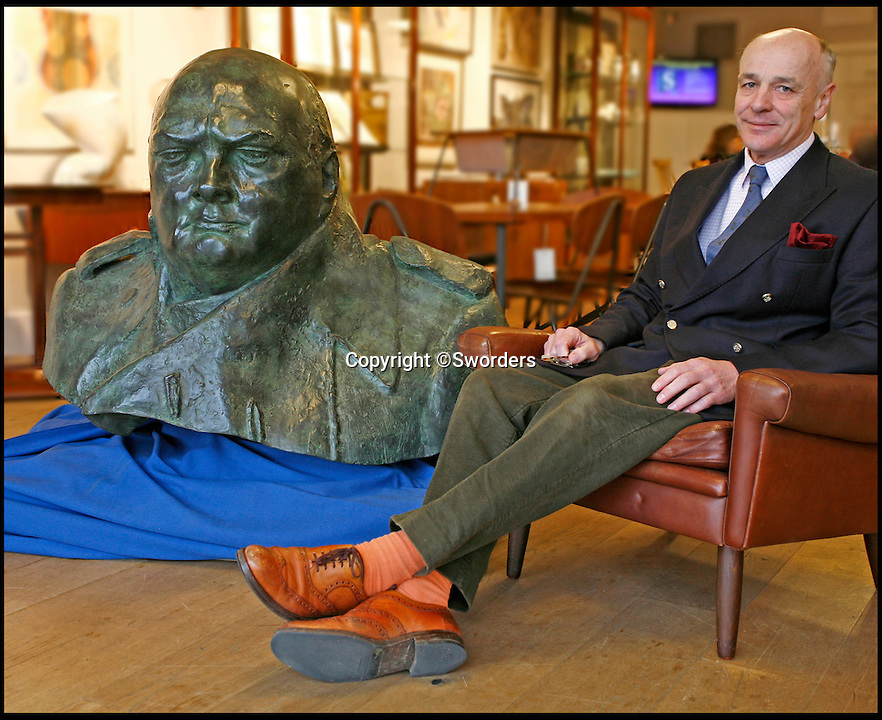 BNPS.co.uk (01202 558833)<br /> Pic: Sworders/BNPS<br /> <br /> Guy Schooling, managing director of Sworders auctioneers.<br /> <br /> This one tonne bronze bust modelled from an iconic statue of Winston Churchill would be quite the conversation piece - but would dominate most living rooms. <br /> <br /> The monumental mould captures the man voted the greatest ever Britain at his most defiant and stands nearly three feet tall, and is so large it takes four people to move it. <br /> <br /> It is one of only six authorised duplicates of the iconic Parliament Square sculpture of the wartime Prime Minister that will ever be made - with bidders from across the world set to fight it out for the  four feet wide piece.