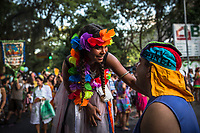 RIO DE JANEIRO, BRAZIL - FEBRUARY 23, 2014: A performer talks to an outpatient of the Instituto Philippe Pinel psychiatric hospital, as their family and friends participate during the annual T&aacute; Pirando, Pirado, Pirou! carnival street parade on February 23, 2014 in Rio De Janeiro, Brazil. It looks like any of the other 450 or so street parties, locally called &ldquo;carnival blocks,&rdquo; that parade through Rio de Janeiro during the raucous pre-Lenten festivities that draw hundreds of thousands to the city each year. What makes this party different are its performers and organizers: psychiatric patients and their doctors, therapists, family members, neighbors and passers-by. The group, called T&aacute; Pirando, Pirado, Pirou!, which roughly translates as &ldquo;We&rsquo;re freaking out, we already freaked out!&rdquo;, began ten years ago when Brazil was in the process of dismantling its century-old system of mental asylums. A law passed in 2001 called for long-term outpatient psychiatric care to be offered primarily in community clinics. The number of such clinics increased more than fivefold in the following decade, while the number of asylum beds for psychiatric patients dropped 40 percent nationwide.<br /> <br /> Daniel Berehulak for The New York Times