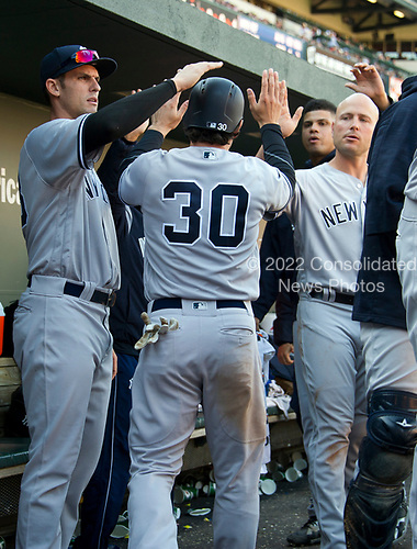 New York Yankees shortstop Pete Kozma (30) celebrates with his teammates after scoring in the ninth inning against the Baltimore Orioles at Oriole Park at Camden Yards in Baltimore, MD on Sunday, April 9, 2017.  The Yankees won the game 7 - 3. <br /> Credit: Ron Sachs / CNP<br /> (RESTRICTION: NO New York or New Jersey Newspapers or newspapers within a 75 mile radius of New York City)