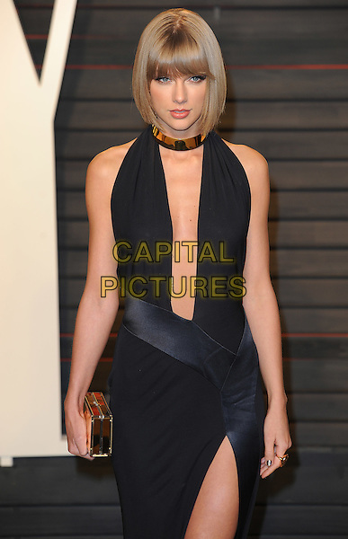 BEVERLY HILLS - FEBRUARY 28: Taylor Swift arrives at the Vanity Fair Oscar Party 2016 at the Wallis Annenberg Center for the Performing Arts on February 28, 2016 in Beverly Hills, California. <br /> CAP/MPI/PWPG <br /> &copy;PWPG/MPI/Capital Pictures