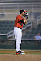 Kannapolis Intimidators relief pitcher Yelmison Peralta (28) looks to his catcher for the sign against the Asheville Tourists at Kannapolis Intimidators Stadium on May 26, 2016 in Kannapolis, North Carolina.  The Tourists defeated the Intimidators 9-6 in 11 innings.  (Brian Westerholt/Four Seam Images)