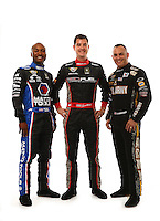 Jan 15, 2015; Jupiter, FL, USA; NHRA top fuel dragster drivers Antron Brown (left), Spencer Massey (center) and Tony Schumacher pose for a portrait during preseason testing at Palm Beach International Raceway. Mandatory Credit: Mark J. Rebilas-USA TODAY Sports