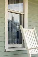 Detail of porch rocking chair and window. Monhegan Island, Maine.