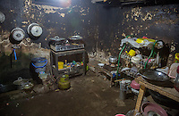 Bali, Indonesia.  A Home Kitchen, Babakan Village.  Propane Gas on Floor, Two-burner Stove on Table.