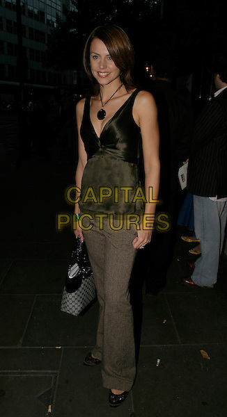 "BEVERLY TURNER.At ""On The Ceiling"" West End Transfer and press night,.Garrick Theatre,.London, 12th September 2005.full length green satin v-neck top circle pendant necklace eye contact brown trousers.www.capitalpictures.com.sales@capitalpictures.com.© Capital Pictures."